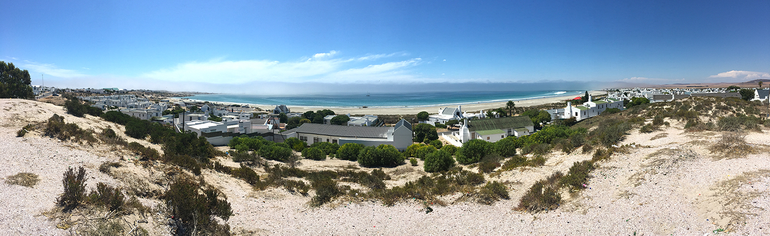 View of Voorstrandt beach from behind The Trading store in Paternoster