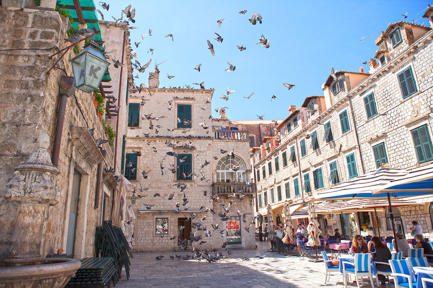 Feeding of pigeons is something that happens everyday in main square of Dubrovnik